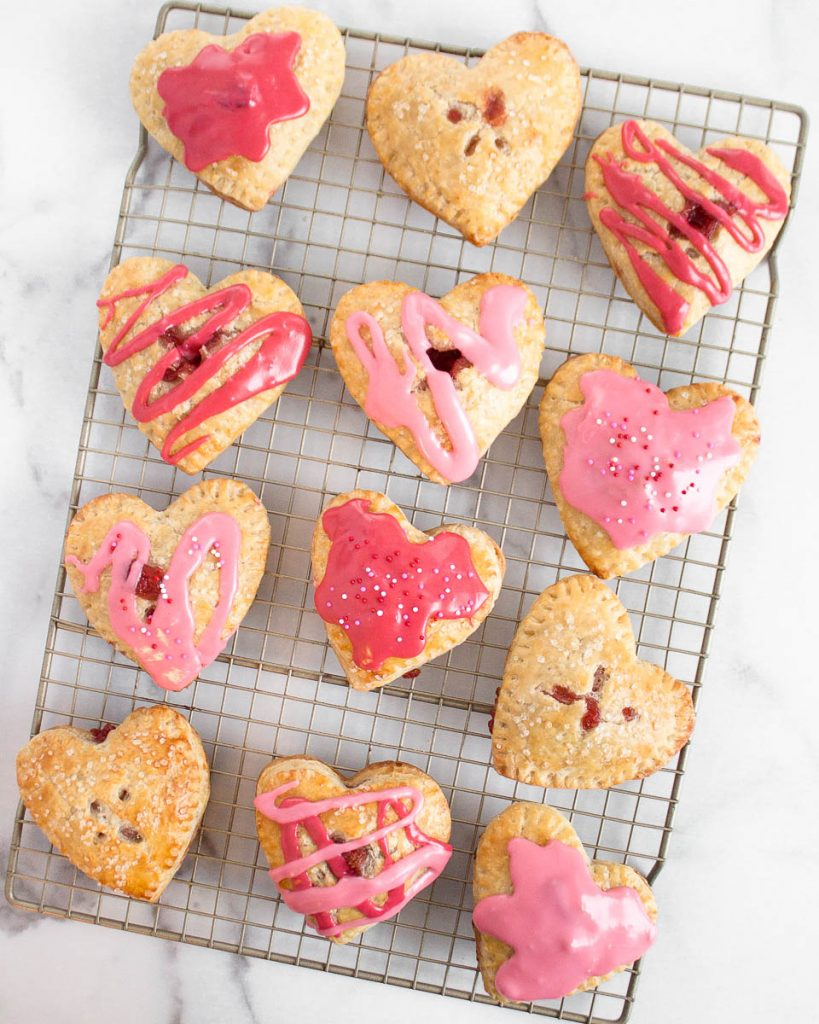 Valentines Heart Shaped Strawberry Hand Pies vanilla glaze